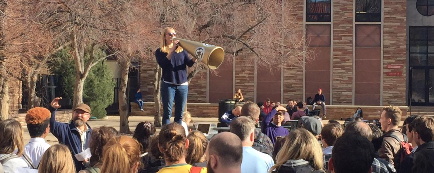 Graduate student Natalie Sharp​ speaks at a rally on campus Wednesday, Nov. 29