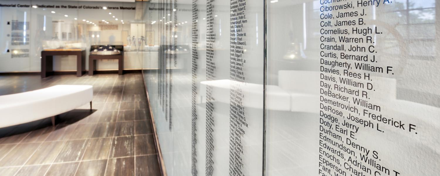 Veterans names fill the walls of the Veterans Memorial Lounge on campus