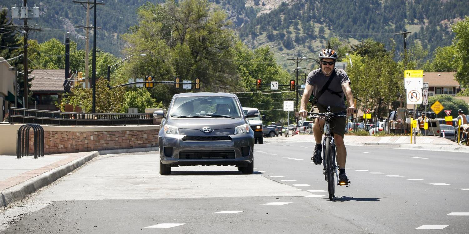 Aaron Johnson rides bicycle on road with motorists