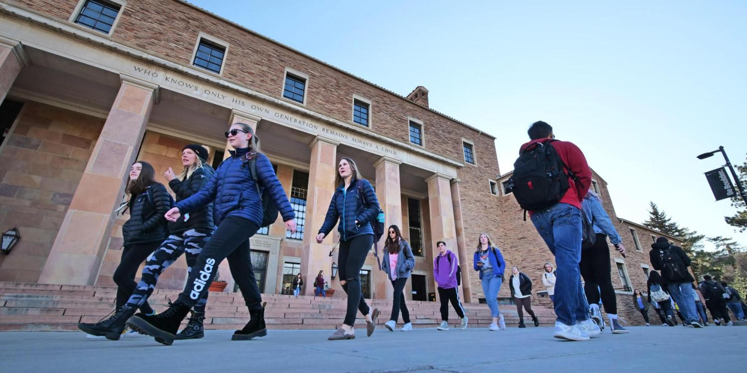 Students make their way past Norlin Library on the first day of classes for spring 2020 at CU Boulder. (Photo by Casey A. Cass/University of Colorado)