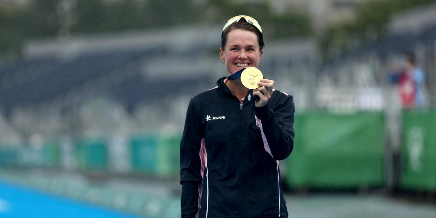 Flora Duffy, a former Buff, holds her Olympic Gold medal