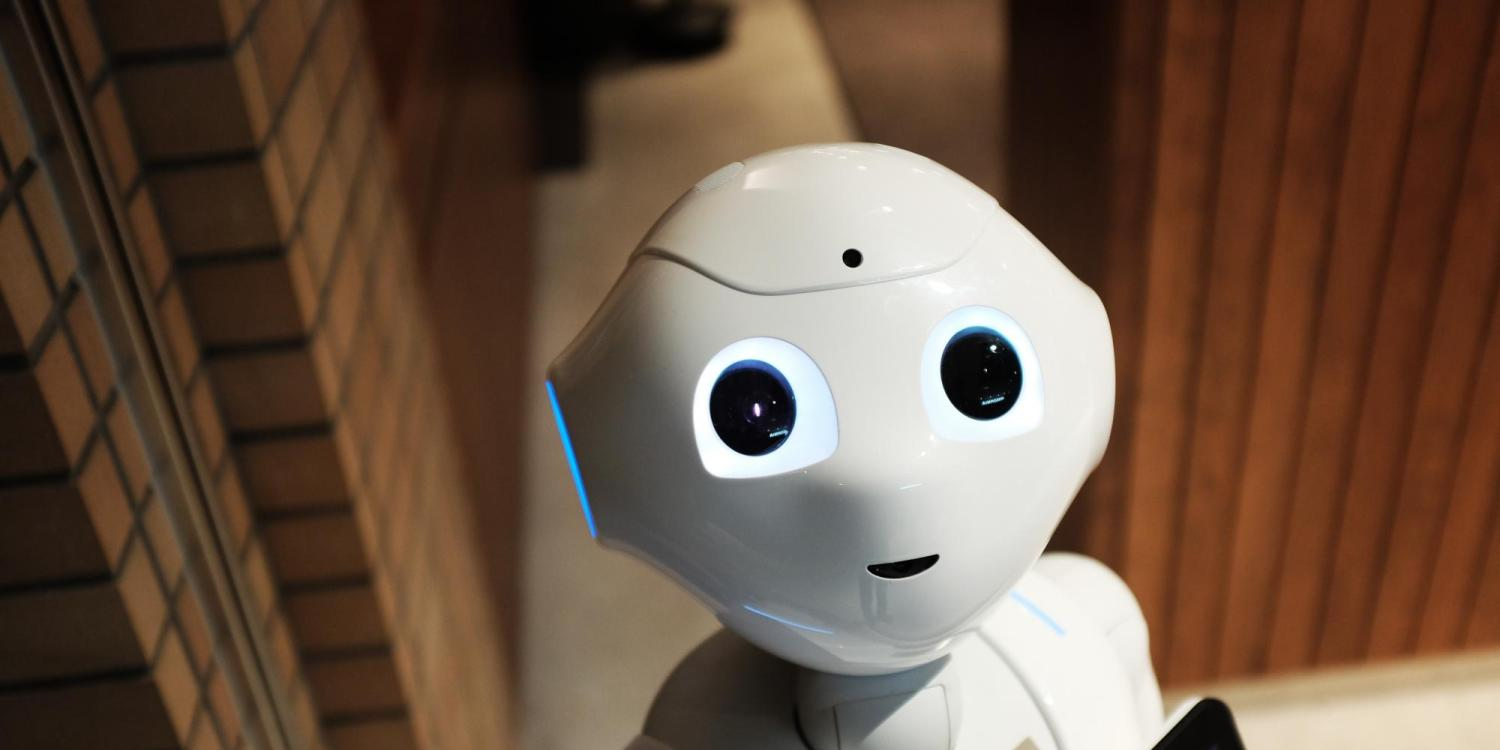 A white robot looking up.