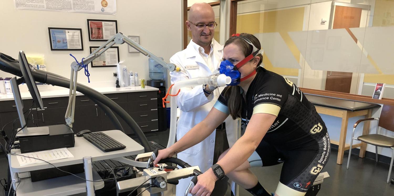 Inigo San Millan with a patient