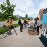 Cyclists check in at the Biofrontiers station by the Jennie Smoly Caruthers Biotechnology Building on the CU Boulder East Campus during the 2019 Bike to Work Day in Boulder. (Photo by Glenn Asakawa/University of Colorado)