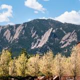 View of the Flatirons from CU Boulder campus in spring.