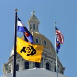 Colorado state capitol building with state, national and CU flags flying