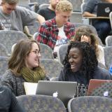 Students talk, sit in auditorium