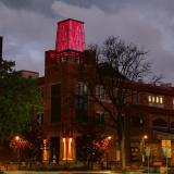 The ATLAS Building towers shines red to honor Coloradans lost to COVID-19 on Friday, May 15, 2020. (Photo by Casey A. Cass/University of Colorado)
