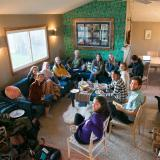 Graduate students gather at David Ciplet's home to share podcasts