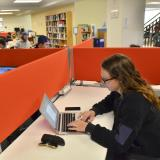 Students at computers in Business Library