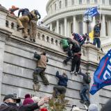 Rioters scale a wall at the Capitol on January 6, 2021. (Credit: CC image via Flickr)