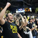 Fans cheer on the CU men's basketball team