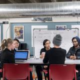 Students talk over coffee in the Idea Forge
