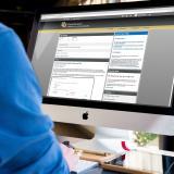 Man accesses D2L on desktop computer