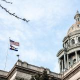 Denver capitol building with state and national flag flying