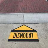 Dismount sign on campus