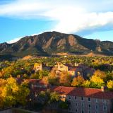 A scenic image of the Flatirons with CU Boulder in the foreground