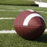football lying on grass field