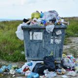 An overflowing dumpster.