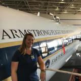 Jessica Gilman in front of a research plane
