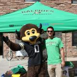 Chip the Buffalo with a Green Stampede volunteer