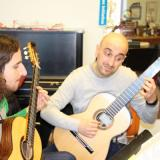 Matteo Mela works with participant in International Guitar Festival