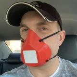 Nick Schuster wearing a mask he printed
