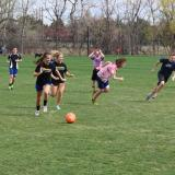 CU Boulder students playing soccer.