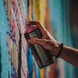 A person using a spray paint can