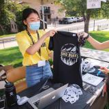 Students in masks selling Sko Buffs t-shirts