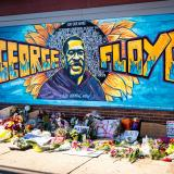 A mural at a memorial site for George Floyd. Photo by munshots on Unsplash