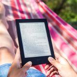 A person reading a book on an e-reader