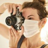 photographer wearing a mask