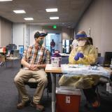 Student receiving vaccine.