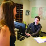 Student talks with residence hall advisor