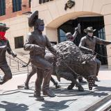 Ralphie running statue with face coverings