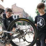 Two students tune up a bike at the UMC Bike Station