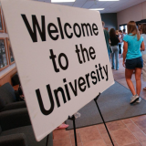 Welcome to the university sign.
