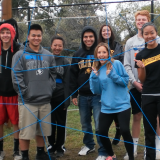 Students standing in an obstacle course