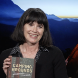 Phoebe Young holding her new book Camping Grounds