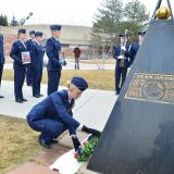 Air Force ROTC cadet leaves rose at shuttle memorial
