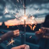 A person holding a sparkler