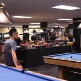 Students play pool at The Connection on campus