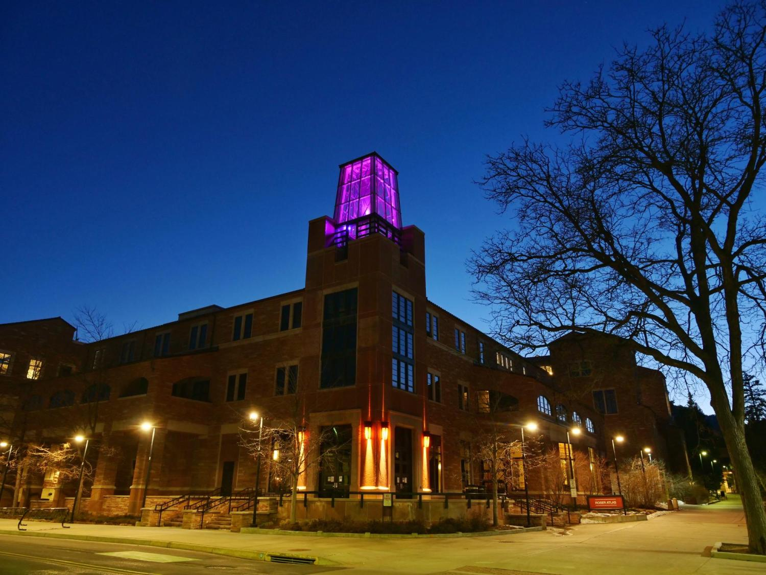 On March 6, the Roser ATLAS building shines magenta––part of the state of Colorado's COVID-19 anniversary remembrance. (Photo by Glenn Asakawa/CU Boulder)