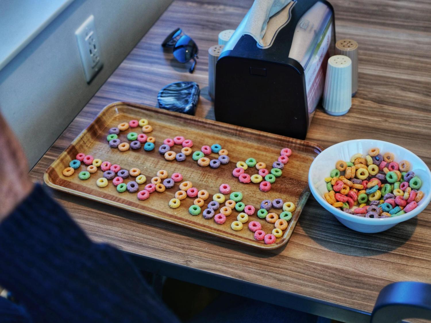 Good morning written in Froot Loops cereal at Village Center. Photo by Glenn Asakawa.