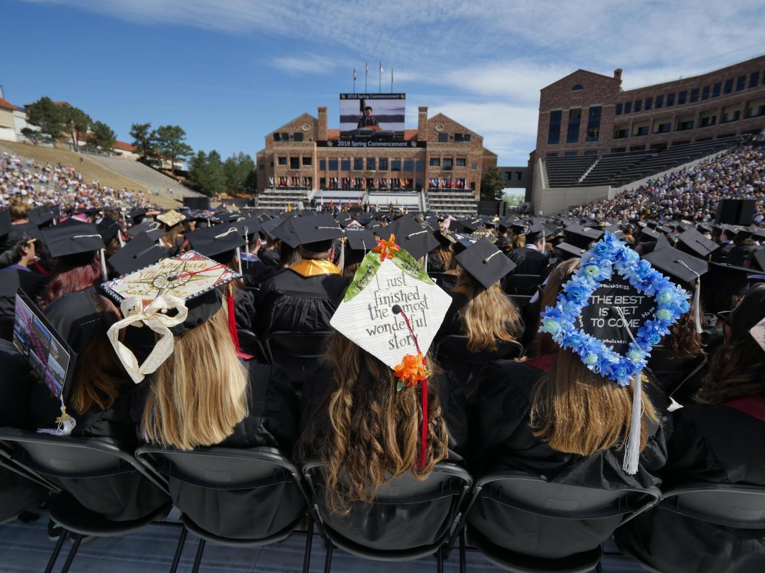 Scenes from CU Boulder's 2018 main commencement ceremony at Folsom Field. Photo by Glenn Asakawa.