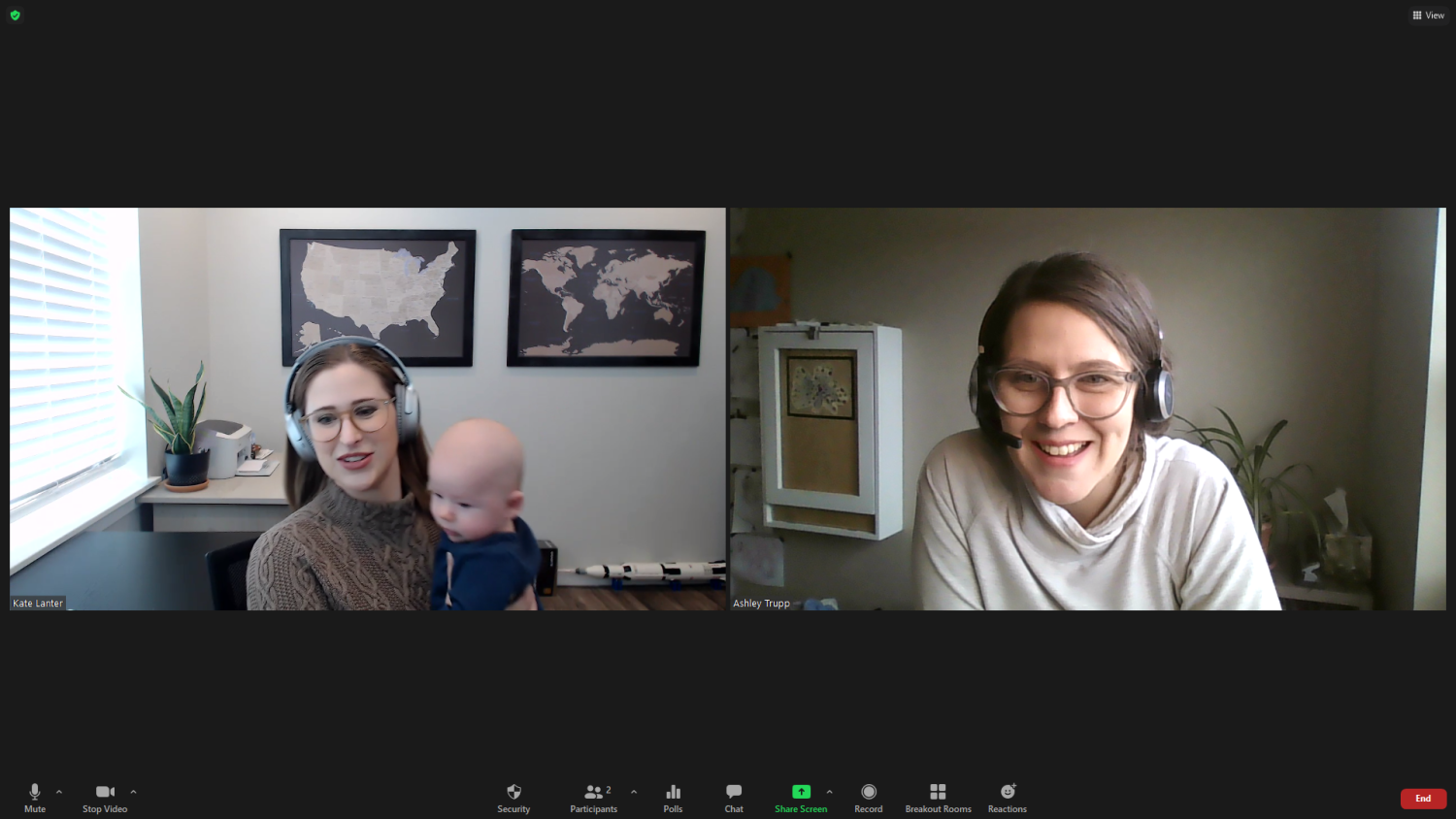 Kate Lanter holding baby while on Zoom call