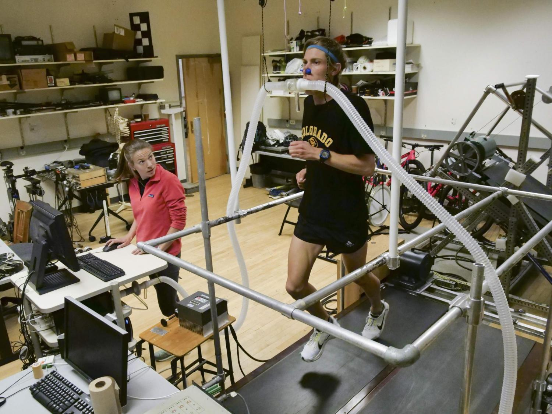 Shalaya Kipp conducts a treadmill study in the Locomotion Lab at CU