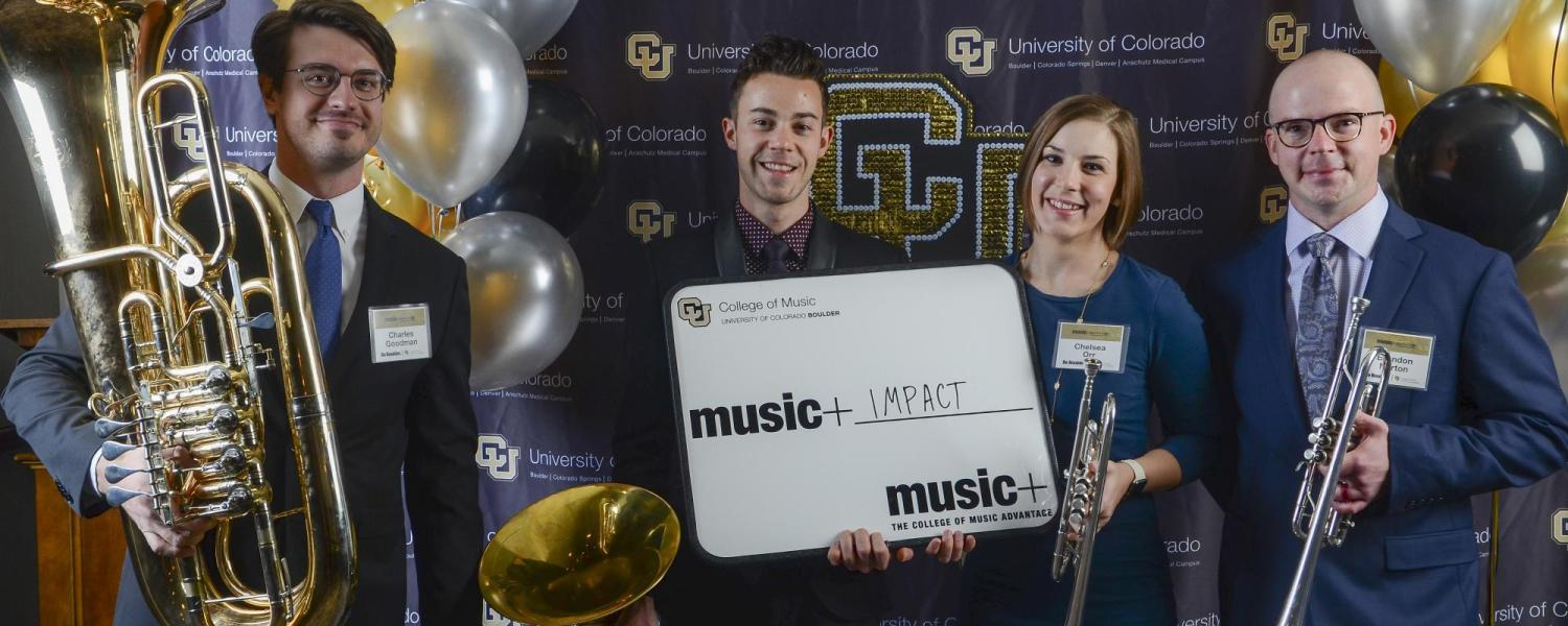 Students pose for photo at music+ kickoff event