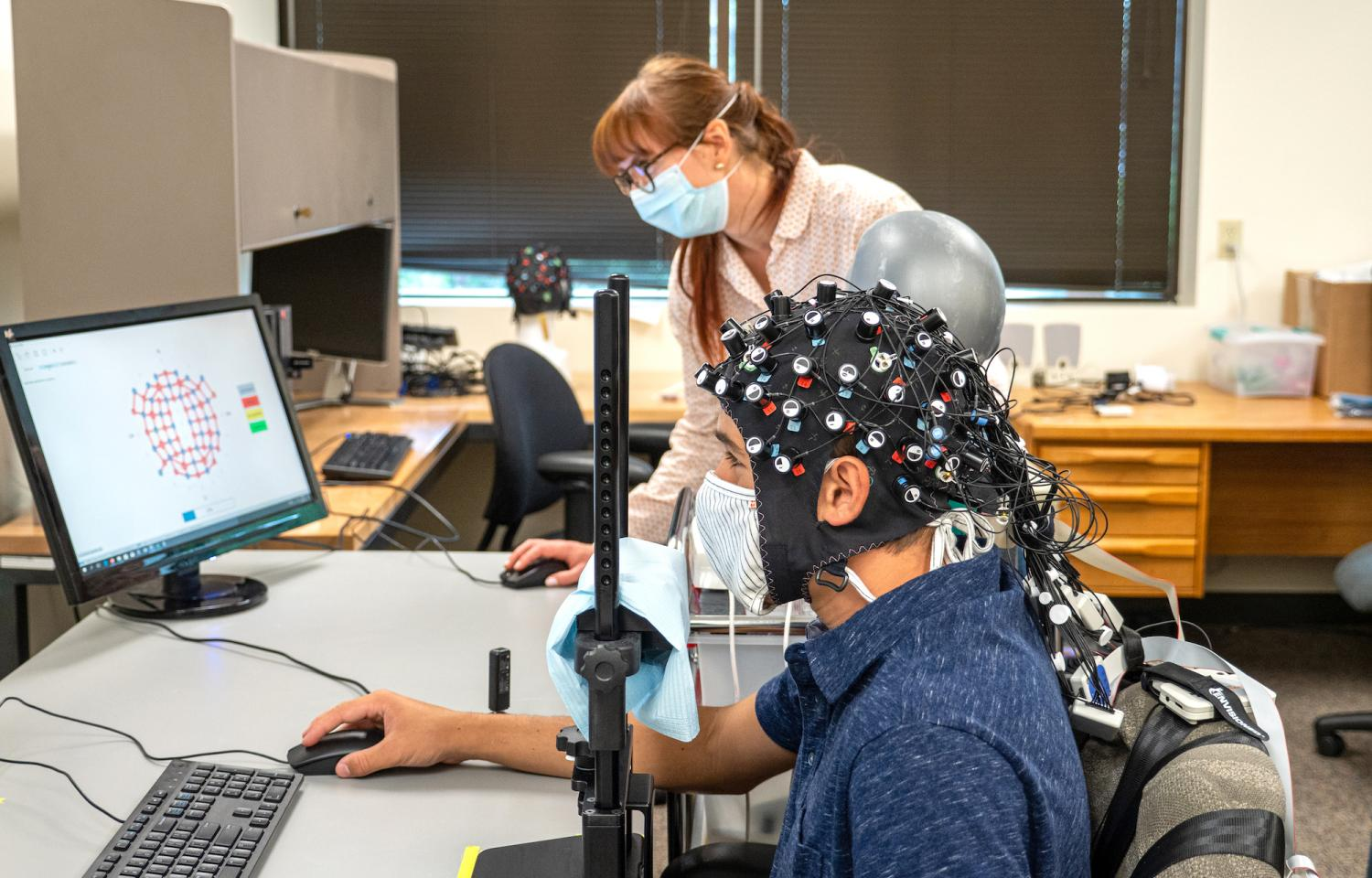 Cooper Steputis wears a functional near-infrared spectroscopy device that monitors his brain activity.